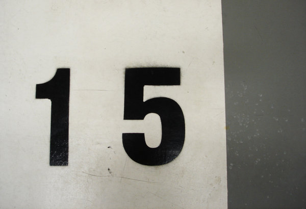 Number 15: A floor numbered parking lot at a local supermarket
