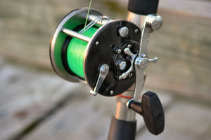 Fishing Reel: Fishing reel standing on the dock
