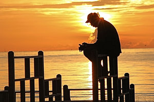Silence: A man praying at sunrise