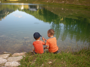 mountain lake: ouch children on a mountain lake in upper austria,