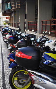 Motorbikes: Bikes parked on the pavement.
