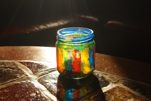 Jar of glass on the table: Painted jar in sunlight