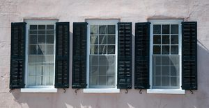 Shuttered Windows: 18th Century shuttered windows, shot in either direct sunlight or filtered light in Charleston, South Carolina, USA