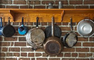 Pots and Pans: Pots and Pans hanging from hooks under a shelf in a southern USA kitchen
