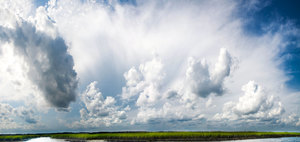 Summer Clouds over water: These clouds were over a natural estuary ecosystem in South Carolina, pristine water, air, not a soul for 22 miles. Hot August day with light breeze, photo taken in the heat of the mid afternoon.