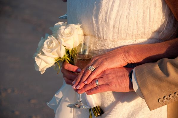 Wedding Accents: Champagne, new rings and the bouquet from a winter wedding on the beach