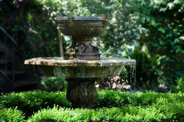 Garden fountain: neo-classical garden fountain, probably erected around 1840-1850. Charleston, South Carolina, USA. Shot in midday filtered light