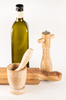 Oil, flavoring and rolling pin: a bottle of olive oil a pepper grinder and a flatter