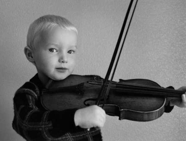 Violinist: This was a picture taken a number of years ago, before digital cameras. I have scanned it in and done a certain amount of retouching and could do with a bit more work but Istill think it is a nice pic. It is of my son David, who is now considerably older.