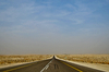Driving on a desert road: Driving on a desert road in the desert sands of Saudi Arabia. No people and No life in this desert , only desert lovers and desert traveler who travel in the desert and have destination the desert or destination Saudi Arabia. This image is suitable to web