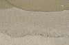 Sand close up on sandy beach: Sand and sea wave close up. simple minimal image o the beach