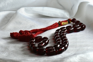 Beaded string from Saudi arabi: Beautiful and traditional Beaded string from Saudi Arabia for men to play and hang out and spend the time playing with the beads that are so colourful and red and are so shiny glass like material. Arabic custom but also found in Cyprus and Greece . Old me