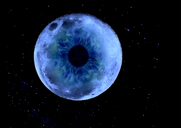 Eye in the Sky: composite image of an eye and blue moon in the sky