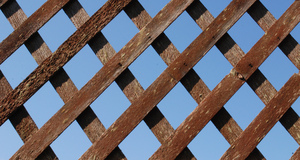 Wood Lattice: Wood lattice against a blue sky for backgrounds.