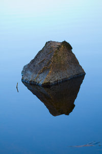 Stone Levitation: The stone seems to be flying over the surface