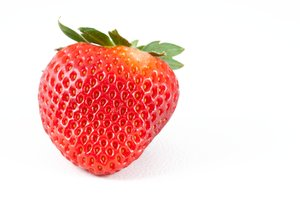 Strawberry Close-up: Strawberry close-up isolated on a white background.