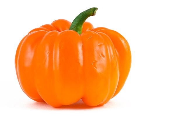 Orange Bell Pepper: Orange bell pepper isolated on a white background.