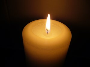 Burning Candle: A lighted candle