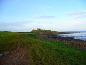 Dunstanburgh Castle 1: Located on the Northumberland coast, Dunstanburgh Castle was a Lancastrian stronghold during the Wars of the Roses (1455 - 1485). Heavy cannon damage left the castle in ruins, the condition in which it remains today. It's now owned by the National Trust a