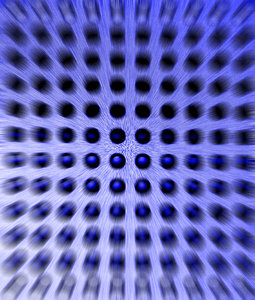 Zoomin' Blues: Macro shot of a PC speaker, converted to mono, colourized and Zoom Blur added.