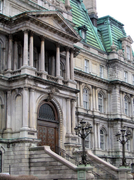 Montreal 3: Sights in Montreal, Quebec, Canada.The 5 storey Montreal City Hall (Hôtel de Ville) is the work of architects Henri-Maurice Perrault and Alexander Cowper Hutchison, built between 1872 and 1878. Its architecture is in the Second Empire style, also known a