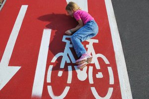 Kid fun on road marked bicycle: Girl funny, jokin on road marked bicycle.