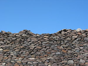 Fifty fifty  - stones and sky: Stone wall and sky captured on the southern part of Gran Canaria island, Spain.
