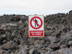 No rock-walking: PLEASE RATE THIS PHOTO!Sign captured on the island Lanzarote recommending not to wlak on the sharp vulcanic rock field.