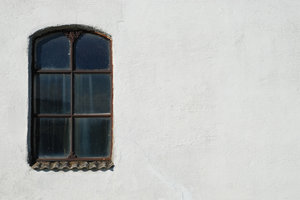 old window and wall: old window and wall, farm building in southern Sweden.