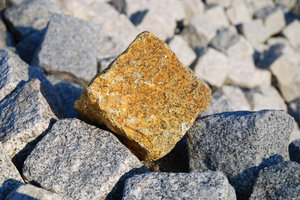 The Odd Stone 3: The odd paving stone in a pile of them.