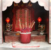 small Chinese shrine: incense burning at small Chinese business shrine altar