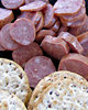 savoury snacks: sliced savoury sausages and cracker biscuits