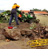 working men & machines1: tree cutting workmen using tree stump grinder