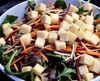bowl of cheese & salad1: cheese cubes on shredded salad vegetables