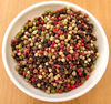 bowl of mixed peppercorns1: medley of peppercorn varieties