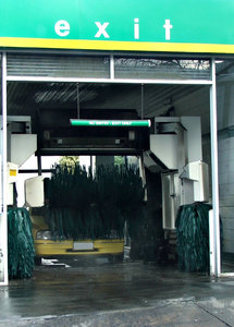 thru the carwash: car being washed in automated conveyor carwash tunnel