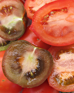 tomatoes - inside story: several varieties of tomatoes sliced open