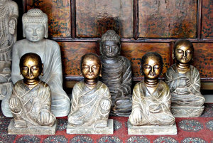 Buddha peace: various carved depictions of the Buddha - garden ornaments