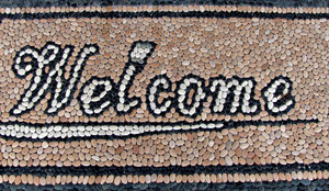 mosaic pebble welcome: entrance 'welcome' mat made from a pebble mosaic