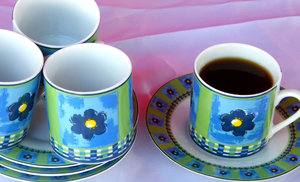 black coffee for one: coffee cups and saucers with one cup of black coffee
