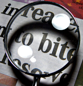 magnify: magnifying glass - magnifyer over newspaper page