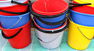 bucket brigade again: selection of brightly coloured plastic buckets
