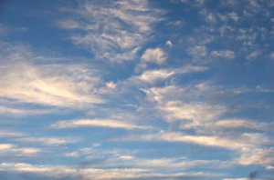clouded sky: thin streaks of fine cloud formations in blue skies