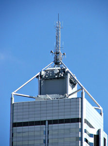 communications on high: communications tower and equipment on top of city highrise building