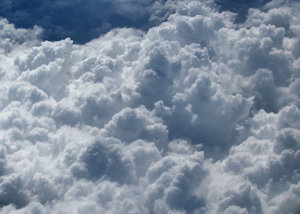 above and below4: clouds seen through plane window during flight