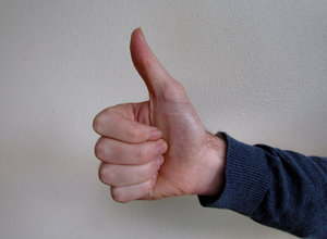 thumbs up1: man's long thumb giving the thumbs up signal