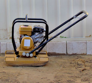compactor1: motorised hand-controlled compactor used in paving and concreting work