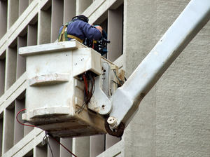 up high: television cameraman filming high up in a cherry picker