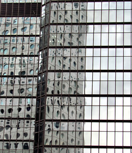 highrise reflections: glass, concrete and steel commercial buildings in Hong Kong reflecting nearby buildings in their windows