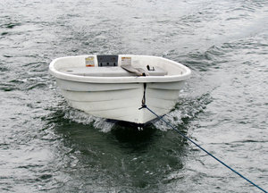 in the wake1: dinghy towed in yacht's wake
